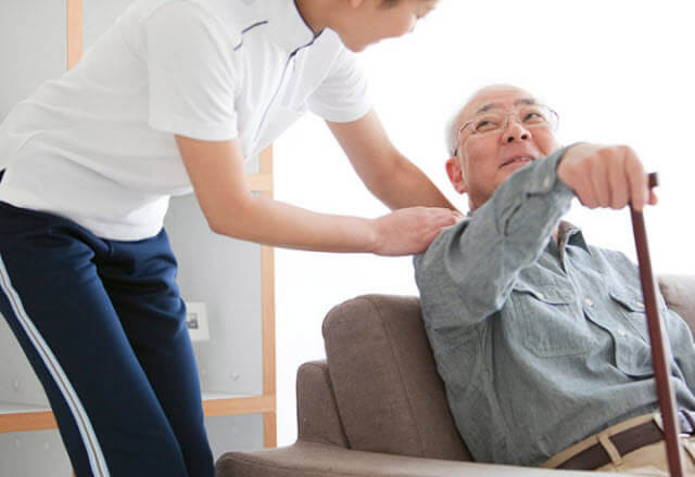 Caretaker looks after a man with Alzheimer's disease