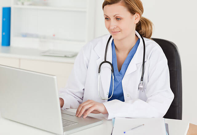 female physician working on laptop