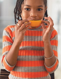Young girl with orange