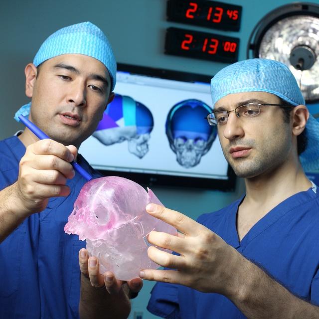 Dr. Ahn and Dr. Dorafshar examine a plastic skull model