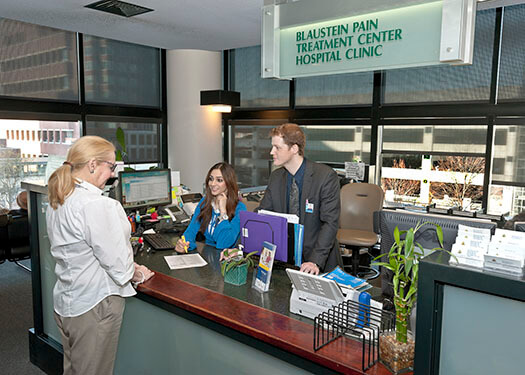 Photo of a patient checking in at the Blaustein Pain Treatment Center