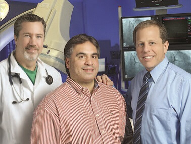Constantine Zuras of Rockville with the two physicians he credits for saving his life