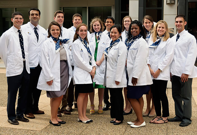 A group of students from the Department of Medicine pose outside for a group shot.
