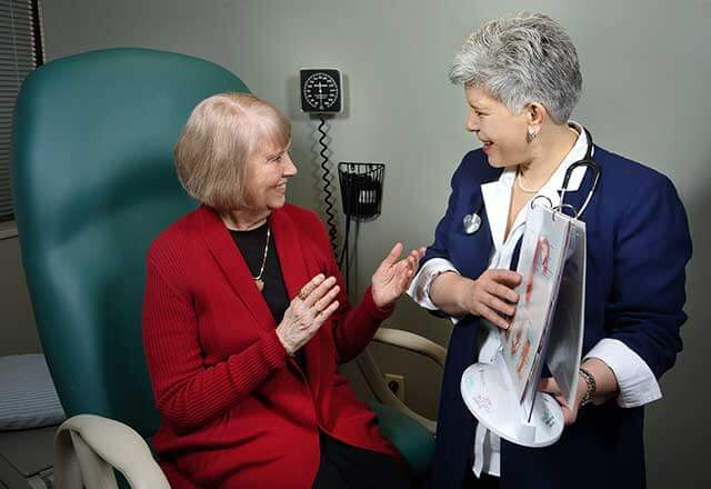 provider talking with patient about menopause management