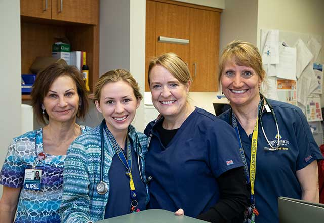 Four smiling nurses.