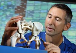 John Tis examining a bone model