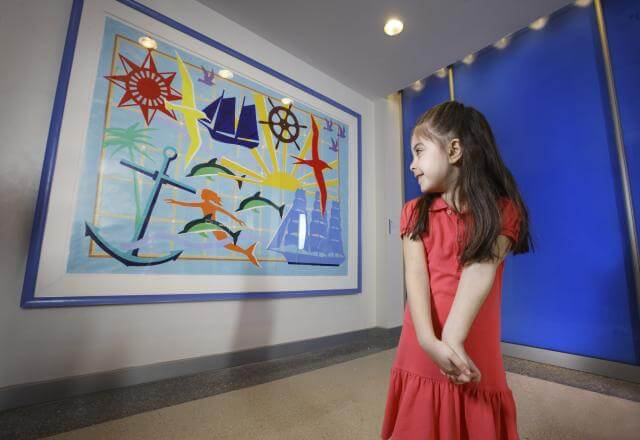 child looking at artwork