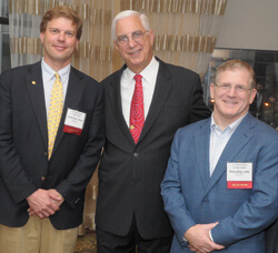 Class of '85 Reunion co-chairs Arnold-Peter Weiss (left) and Ross Jaffe joined Dean Edward Miller in celebrating their class's highly successful fundraising effort.