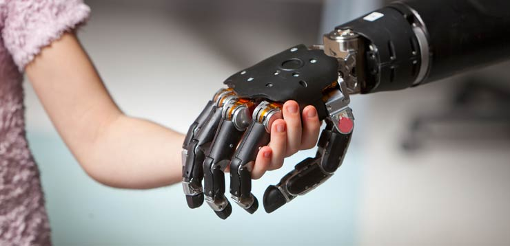 robotic hand holding a childs hand