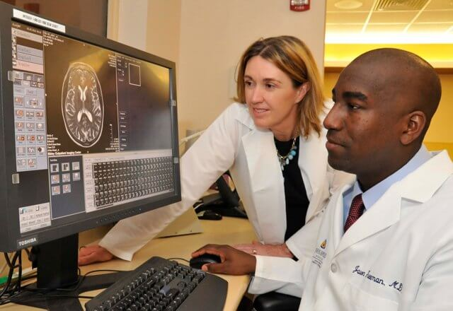 Stroke Center Doctors Reviewing Scan