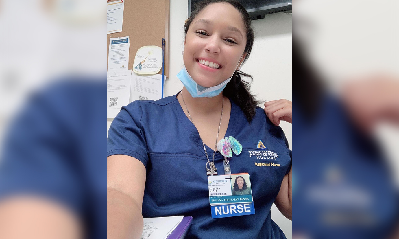 Selfie Photo of Brianna Fogelman in her nursing uniform
