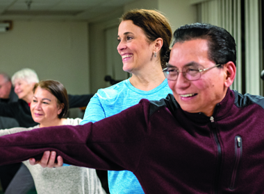 Karin Bertozzi leads a Yoga From the Heart class — a gentle yoga class designed for cardiac patients — at Suburban Hospital.