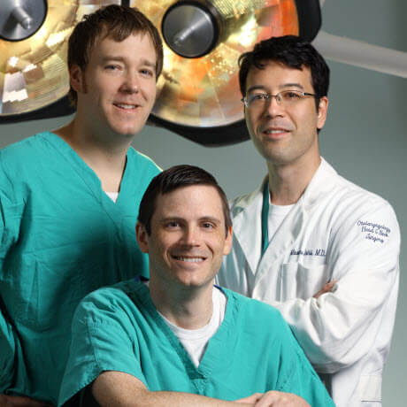 Surgeons Gary Gallia, Douglas Reh, and Masaru Ishii