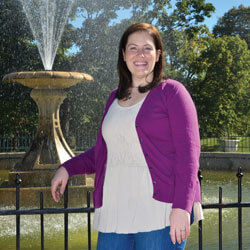 Stephanie Swords standing next to fountain
