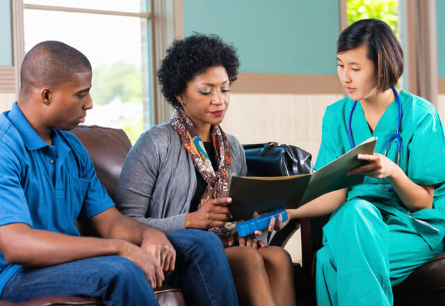 nurse discussing test results with two patients