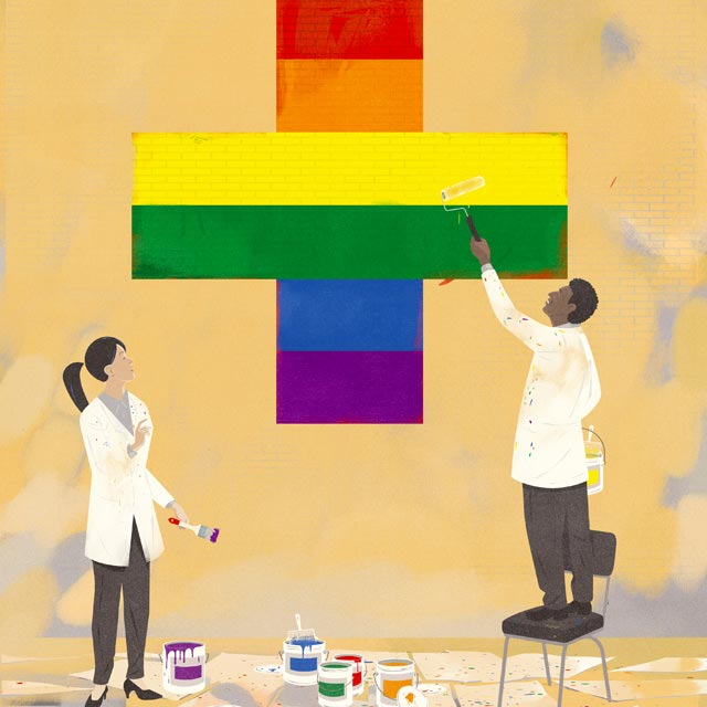 Doctors painting the red medical cross in the colors of the rainbow