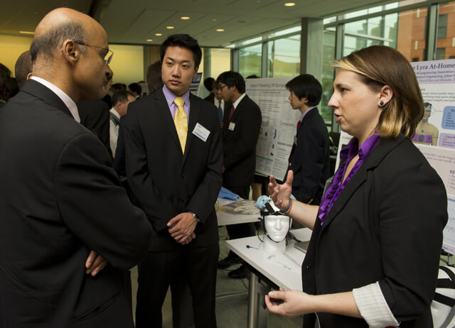 grad students speak with Medtronic