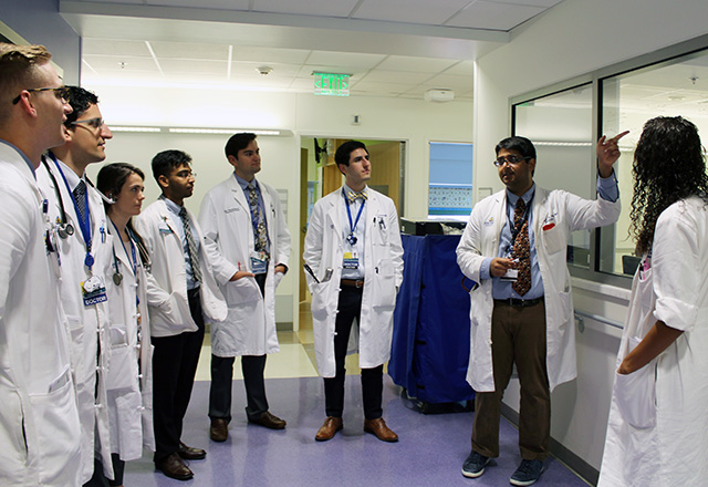 housestaff listening to a physician speak