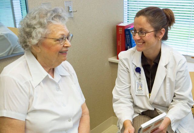 Doctor discusses care with a senior patient