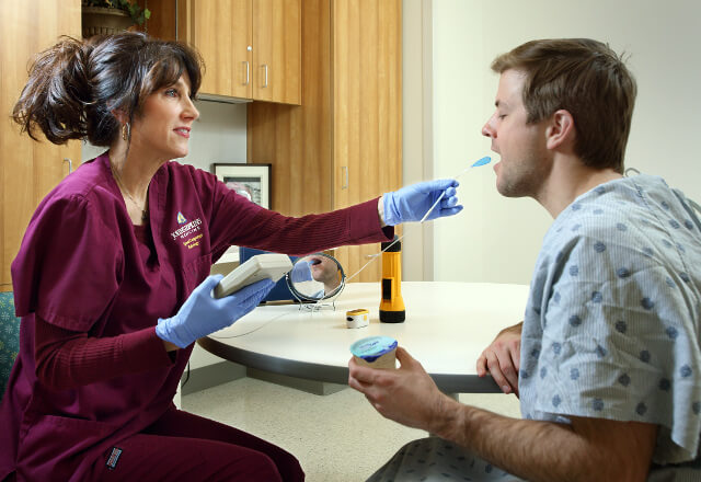 a speech-language pathologist testing a patient