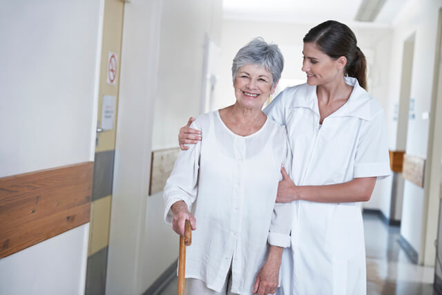 Caregiver assisting patient post-surgery