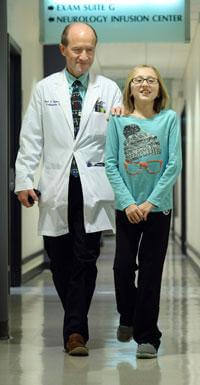 orthopedic surgeon Paul Sponseller with FOP patient