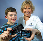 Pediatric nurse educator Loretta Clark teaches patients how to use the latest technology to manage their diabetes
