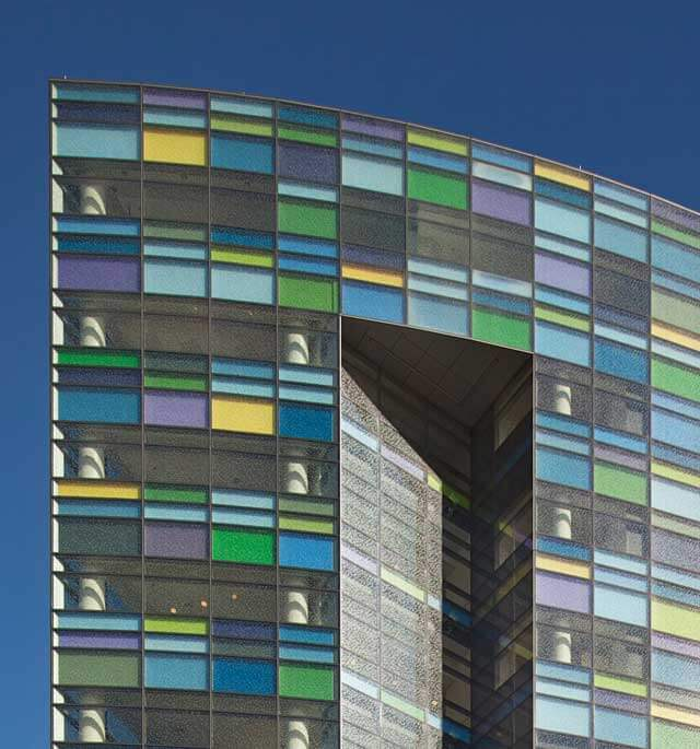 A close-up view of the multi-colored windows of the Sheikh Zayed Tower and Bloomberg Children's Center