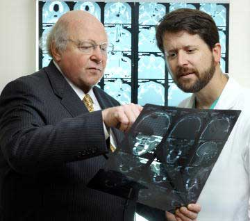 Dr. Manson and Dr. Redett looking at an xray