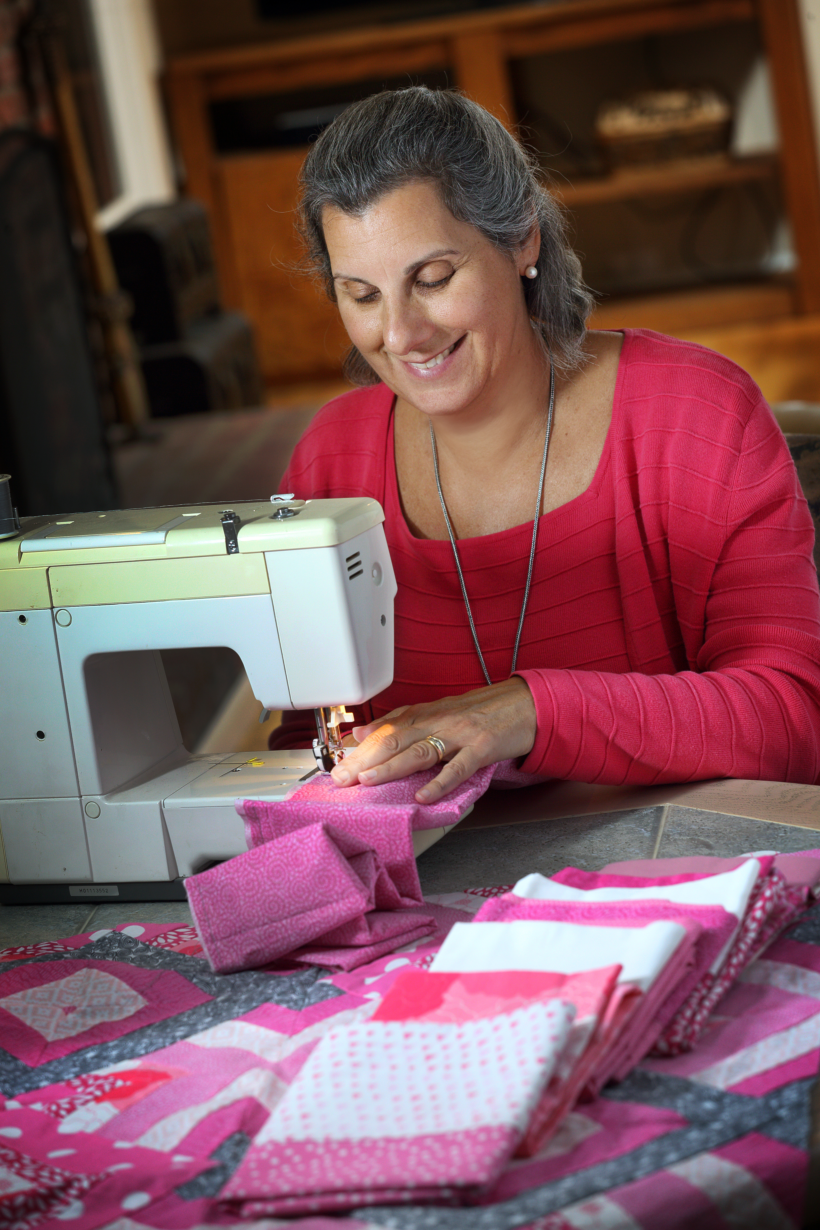 Nurse navigator making pillow cases for breast cancer patients