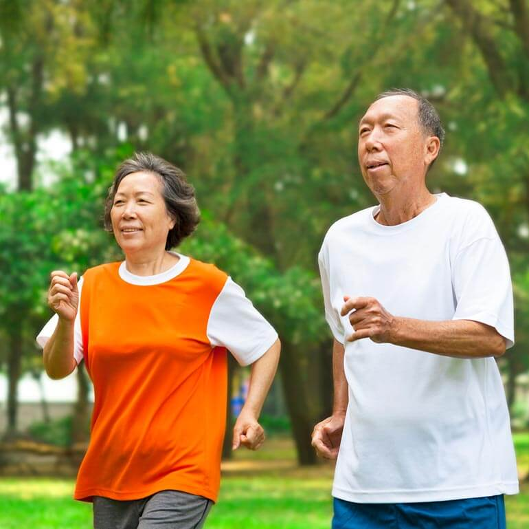 Healthy couple jogging together