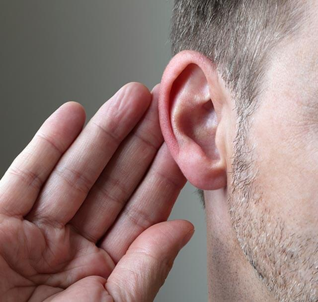 man touching ear