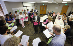 In a simulated exercise, members of the patient move work group act out the roles that caregivers would assume in moving patients from the historic hospital to the new clinical buildings.