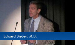 Edward Bieber, M.D. speaking at a podium