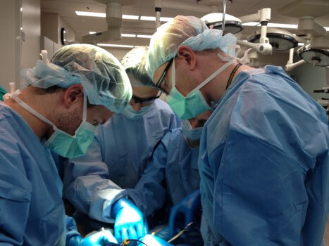 residents performing surgery