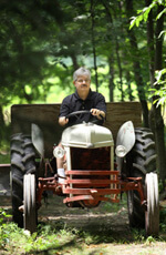 Bill Beatty driving a tractor.