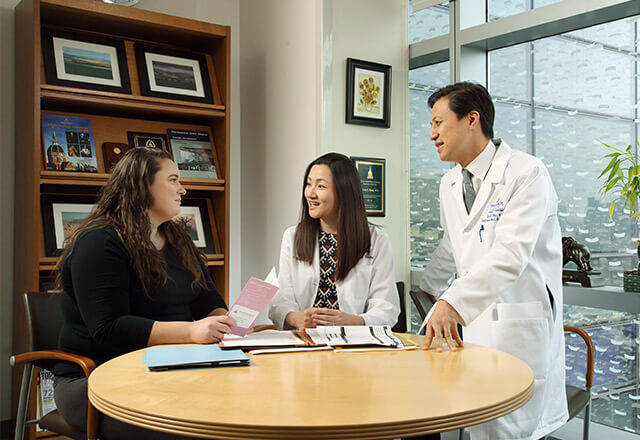 Female patient speaking with Dr. Hong