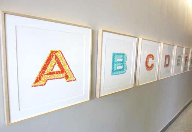 Framed letters of the alphabet, by artist Lauren Adams