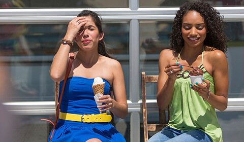 Two friends enjoying ice cream.