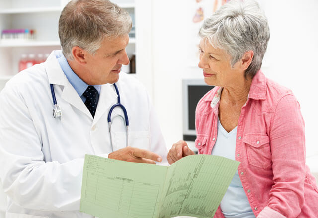 Doctor speaks with patient