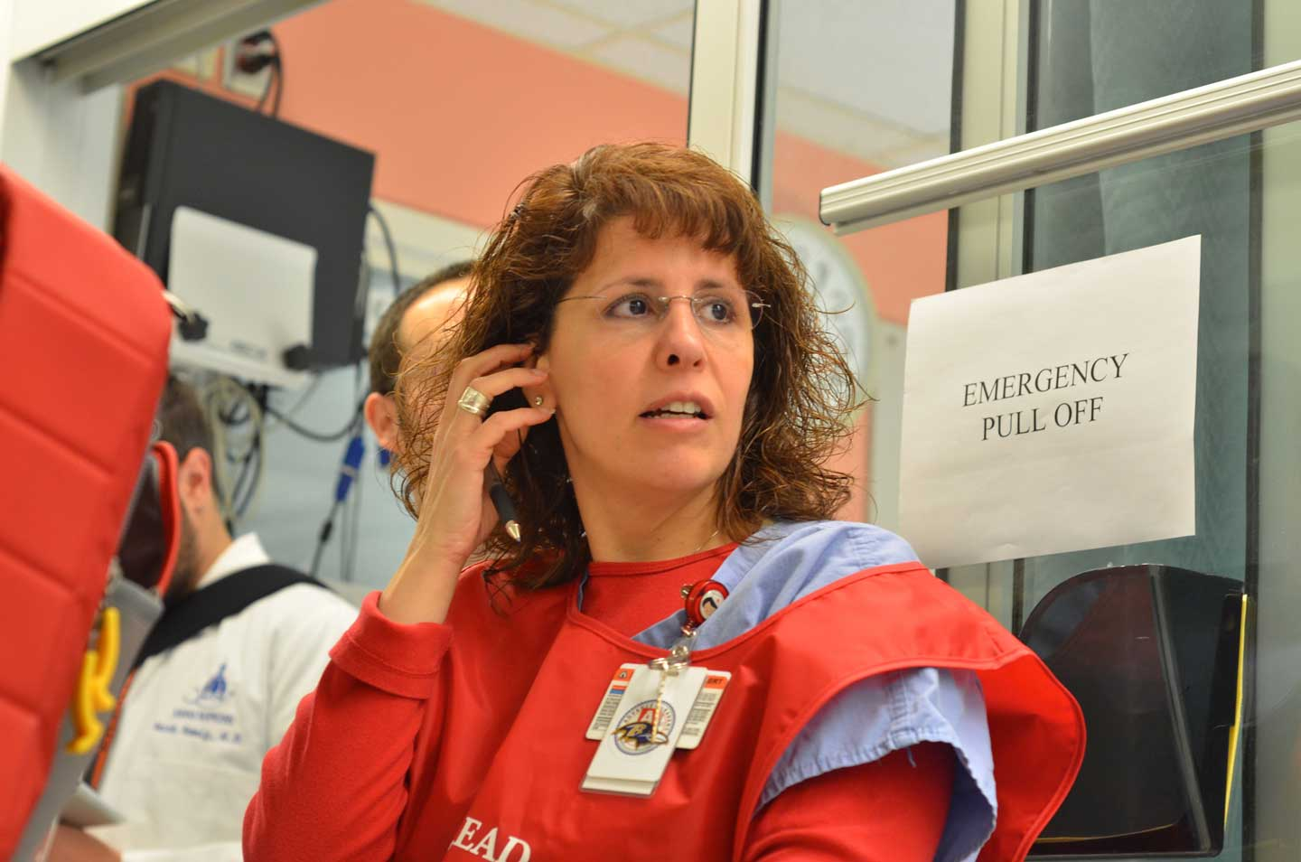 JoAnn Ioannou, the hospital's assistant director of nursing, awaits the go-ahead to transport a patient.