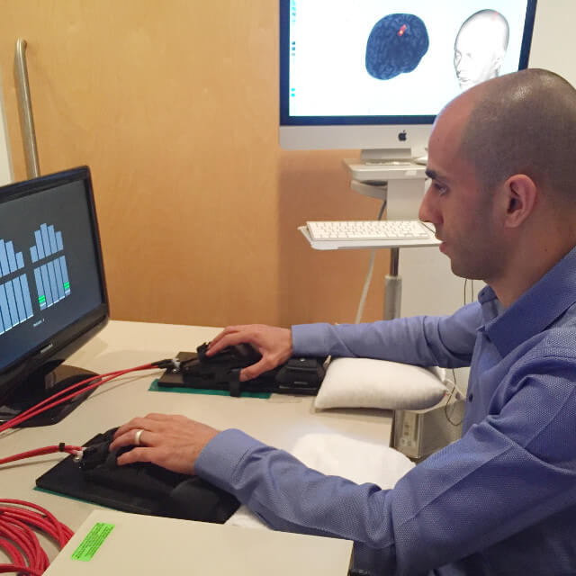 Post-doctoral fellow Firas Mawase in his research lab