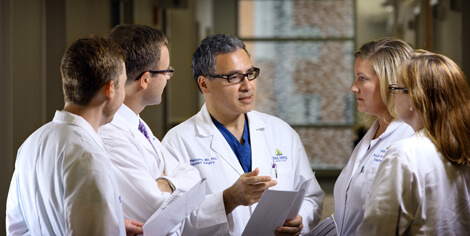 Ben Philosphe meets with members of the surgical team in the live donor liver transplant program at Johns Hopkins, where an average of four live donor operation are performed per year