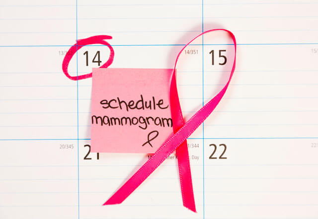 Image of calendar with schedule your mammogram on post-it note