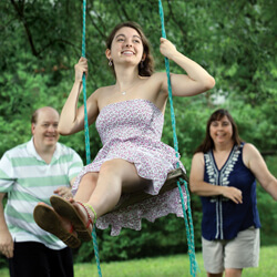 Steve and Robin Lankford pushing their daughter Katie on a swing