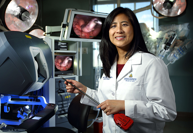 minimally invasive surgery - Dr. Gina Adrales holding instrument in OR