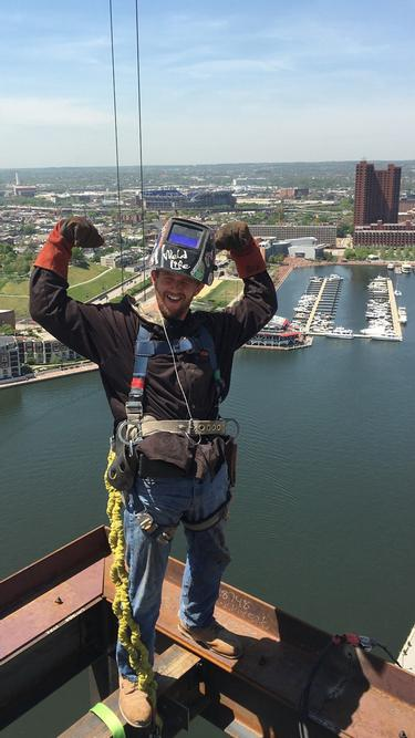 Ironworker Sean Early during construction of a new building in Baltimore.