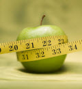 An apple and measuring tape