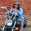 Nikki Jones smiling as she sits on her motorcycle