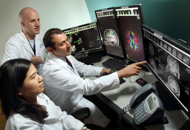 neuroradiologists in reading room